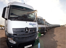 view of a large number of new Acumen Logistics lorries all lined up in a slight curve.