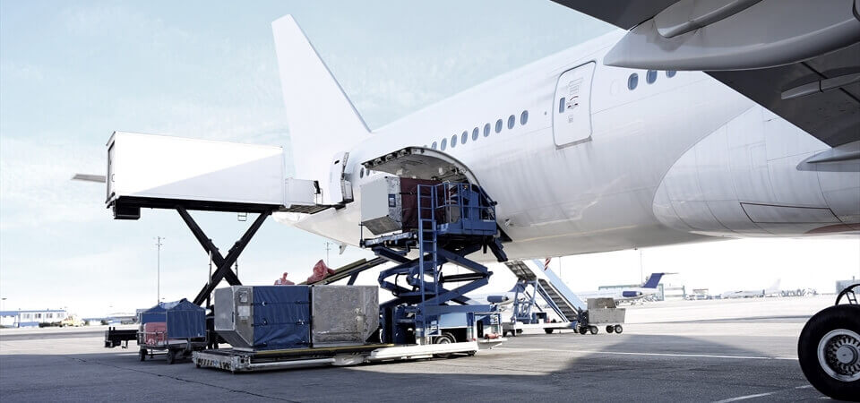 view of an airplane being loaded up with vehicles for emergency freight