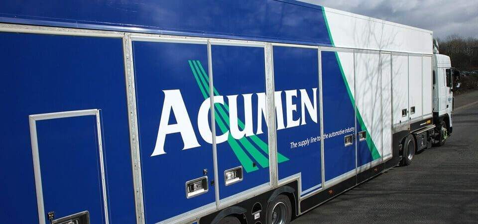 side view of one of Acumen Logistics covered car transport lorries