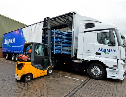 fork lift moving cargo into one of Acumen Logistics distribution lorries.