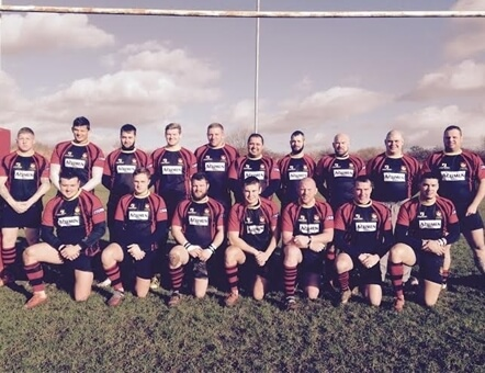 picture of the Pinley Rugby Football Club team on a rugby pitch near the goal
